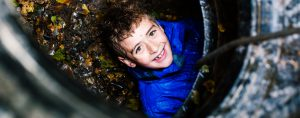 Young boy in tunnel