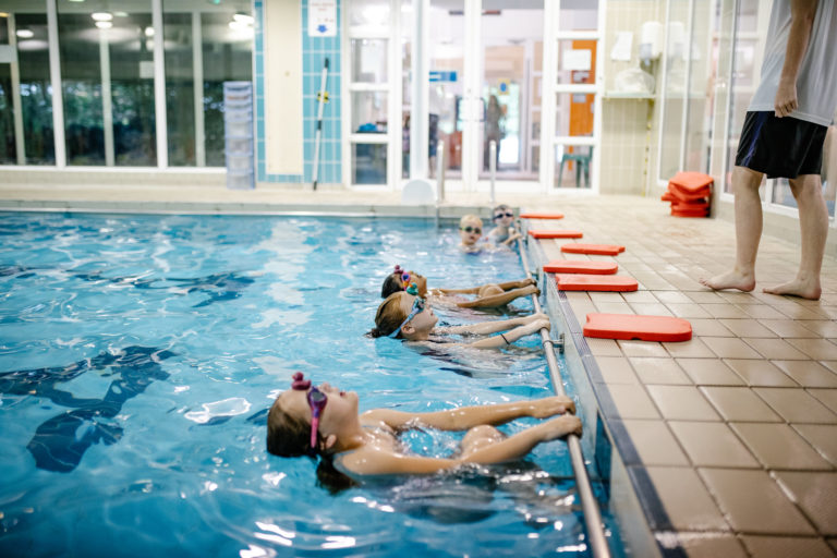 Children in the swimming pool group lesson at Woodrow Leisure Centre, Woodrow High House