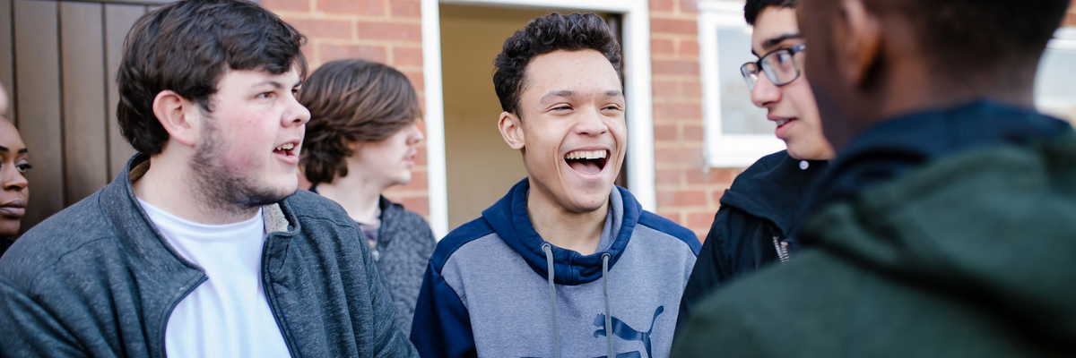 Group of young people laughing at Woodrow High House