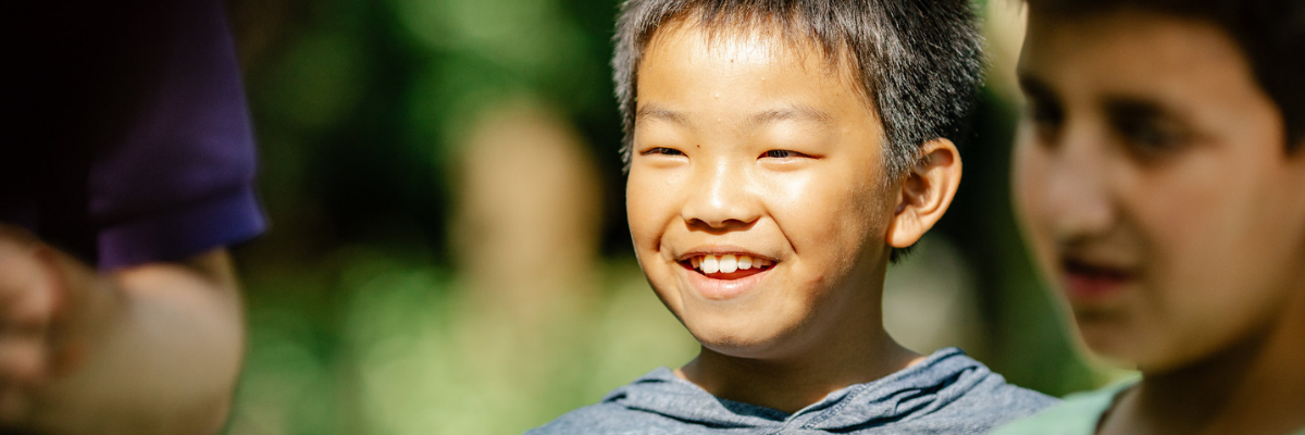 Young boy smiling outdoor activity at Woodrow High House