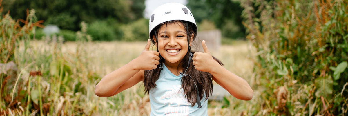 Thumbs up as girl completes the challenge course at Woodrow High House